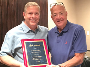 Robert Dodson (left) of Ricardo Beverly Hills, Chairman of the TGA Board of Directors, presents outgoing Chairman Scott Kosmin of 24-7 International (right) with a plaque commemorating his two years of service at the TGA Board of Directors Meeting in Miami Beach, FL.
